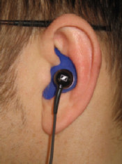 photo shows an Emtec Noisebreaker MP3 in the wearer's ear
