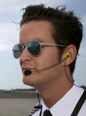 Photo shows a male pilot wearing his Nanocomm GA 2 at the airport